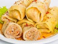Рецепта Печени сарми от кисело зеле с кълцано свинско месо (кайма), праз лук и подправки в глинен гювеч или тава на фурна